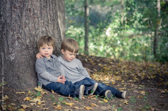 Young brothers sitting in the woods