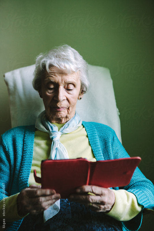 Senior woman using an e-reader by kkgas