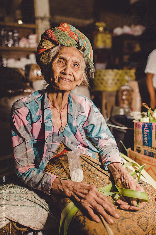 Old Woman Worker in Market in Bali by Gary Radler
