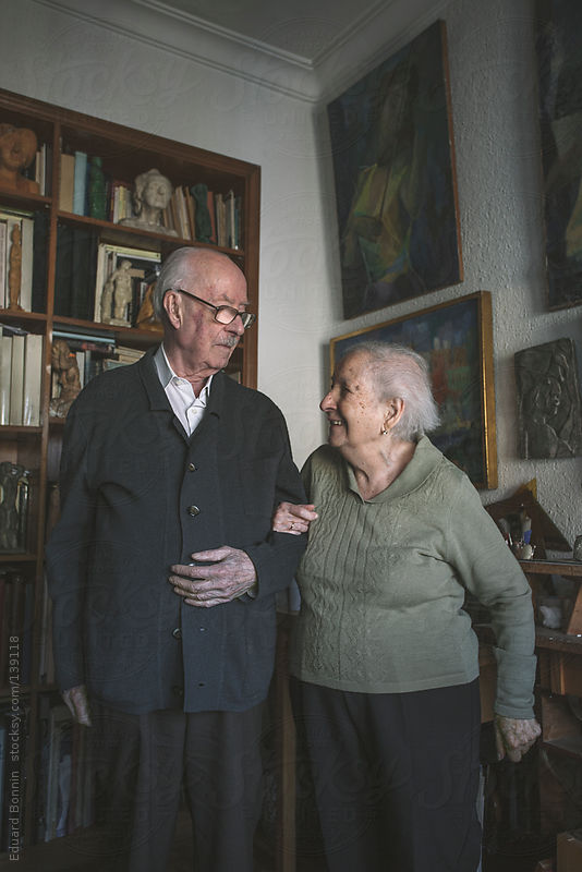 Portrait of old couple standing on artistic studio in home. by Eduard Bonnin