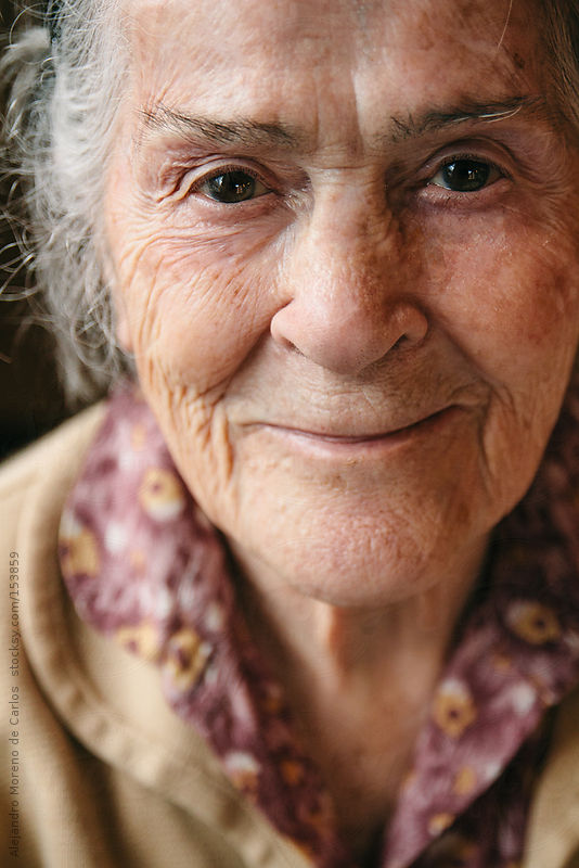 Senior woman portrait. Happy grandmother smiling by Alejandro Moreno de Carlos