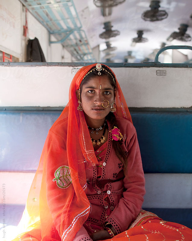 Portrait of Rajasthani woman sitting on train by Hugh Sitton