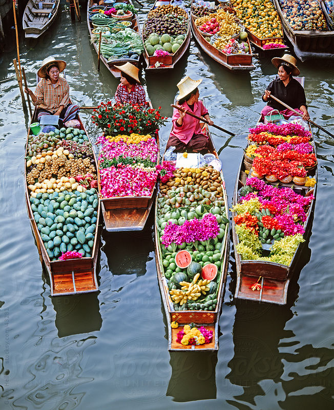 Women market traders in boats laden with fruit and flowers, Damnoen Saduak floating market, Bangkok, Thailand, Southeast Asia, Asia by Gavin Hellier