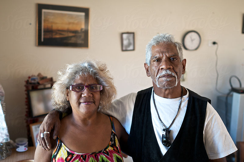 Mid-Adult Aboriginal Man and Woman indoors by Gary Radler