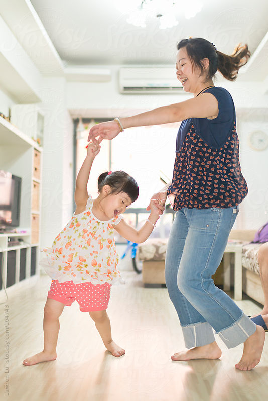 girl dancing with mother at home by Lawren Lu