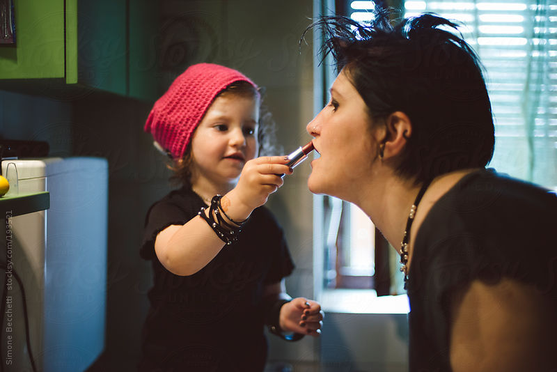 Punk mother with her little girl having fun by Simone Becchetti