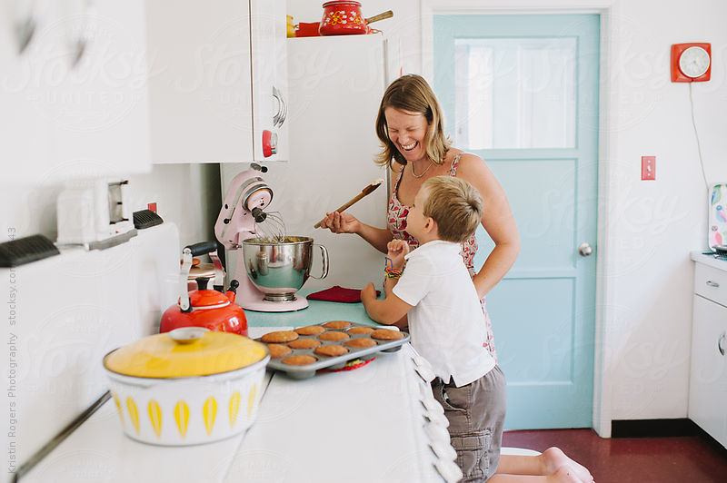 Mother baking with son in cute kitchen by Kristin Rogers Photography
