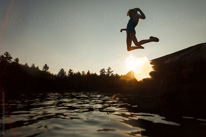 Little Girl Jumping into Lake in Summer by JP Danko