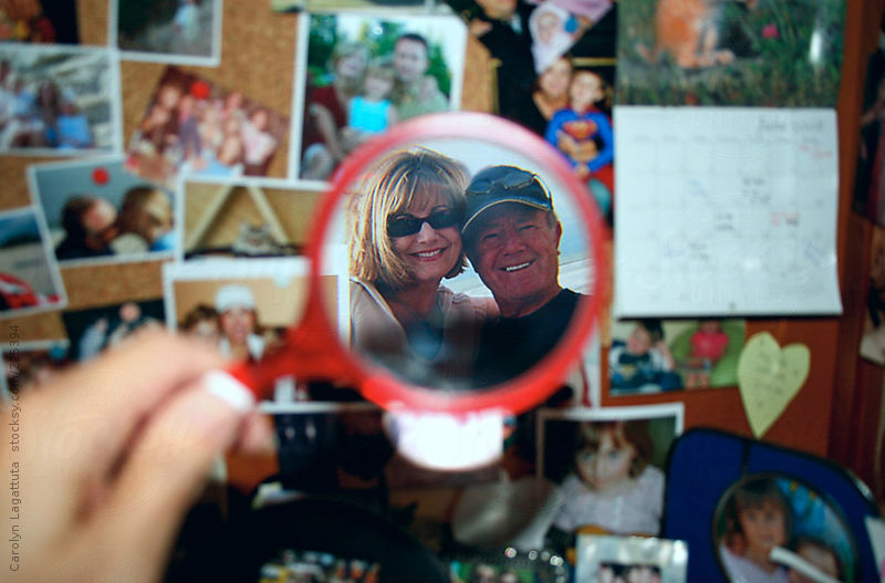 Photo of a girl and her father smiling - photo highlighted with a magnifying glass by Carolyn Lagattuta