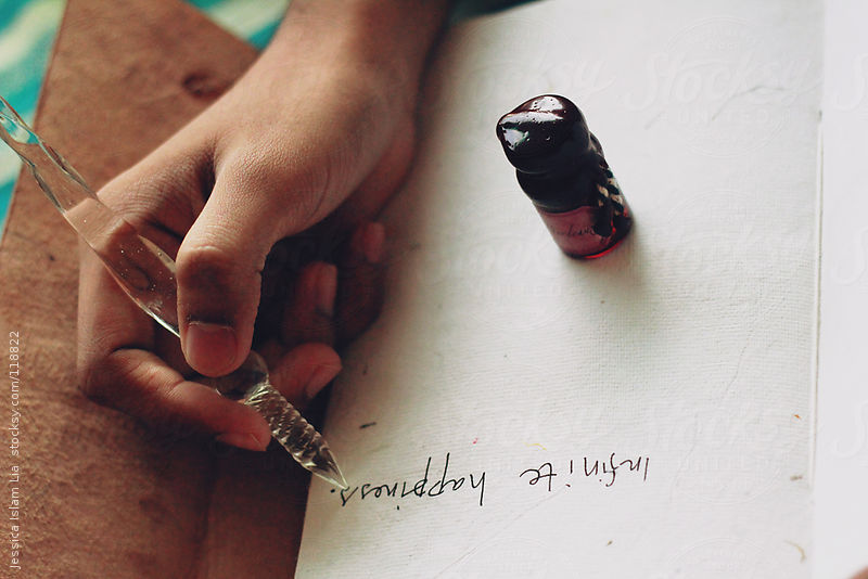writing with fountain pen on the paper by Lia & Fahad