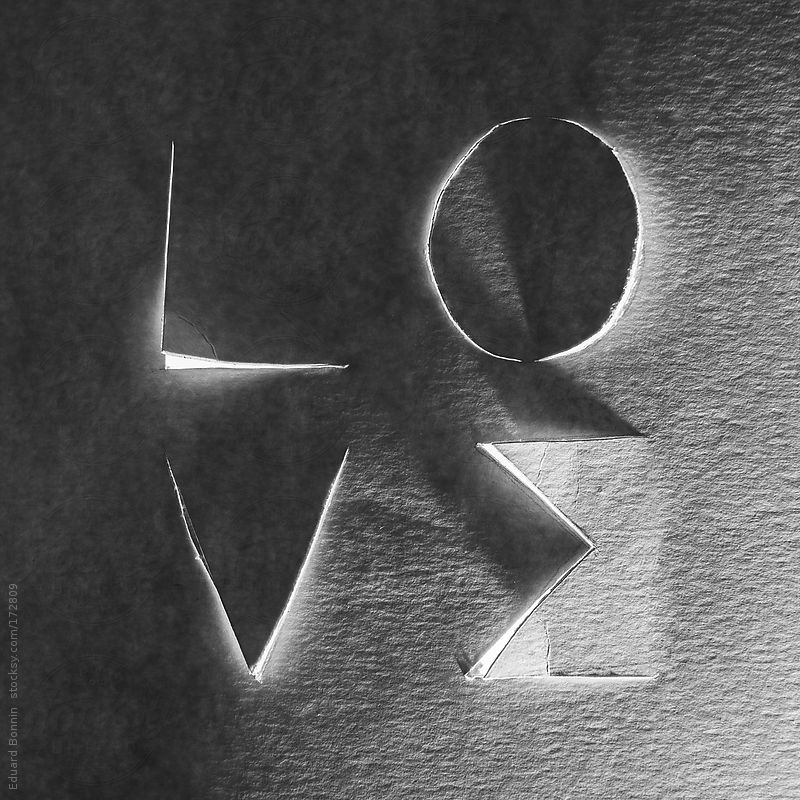 Love word cropped on cardboard. Black and white photo. by Eduard Bonnin