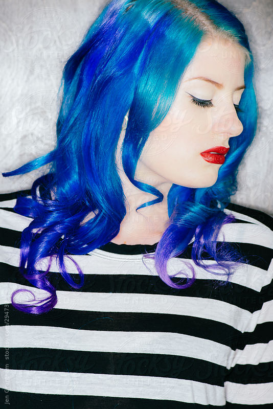 Model with blue hair in harsh light by Jen Grantham