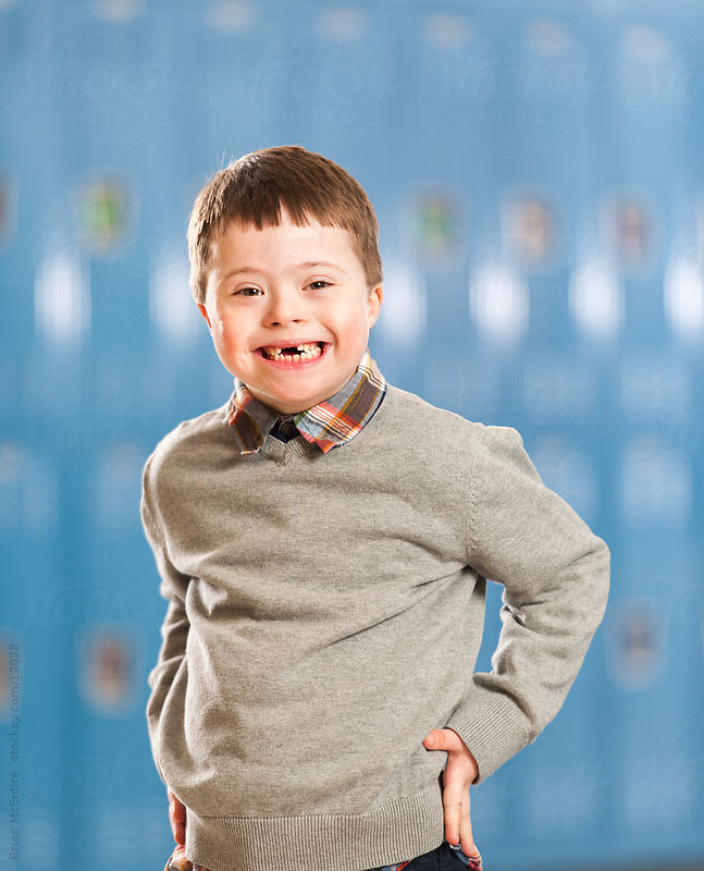 Elementary aged boy with Down Syndrom with School Lockers in Background by Brian McEntire