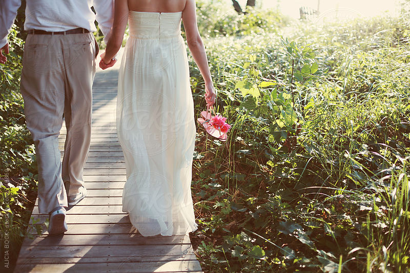 Bride and Groom Walking by Alicia Bock
