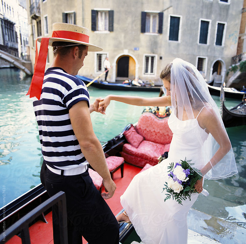 Bride getting into gondola. Venice. Italy. by Hugh Sitton