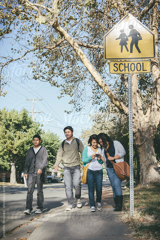 Group of High School American Minority Students Walking Home Together by Joselito Briones