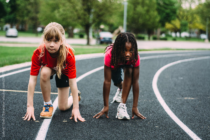 Two Girls At The Start Line of a School Running Track by Gabriel Bucataru