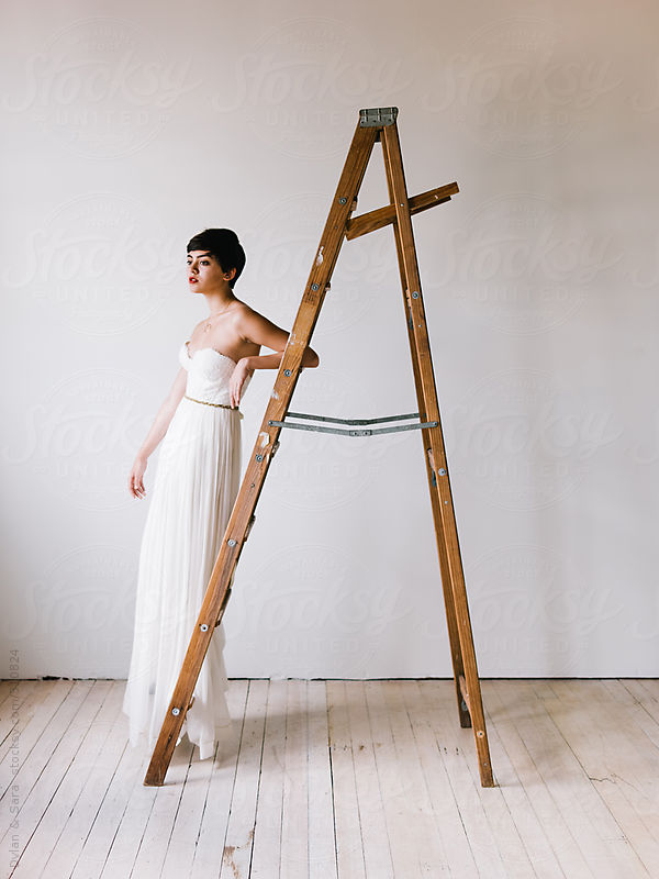 Girl in Wedding Dress on Ladder by Dylan & Sara