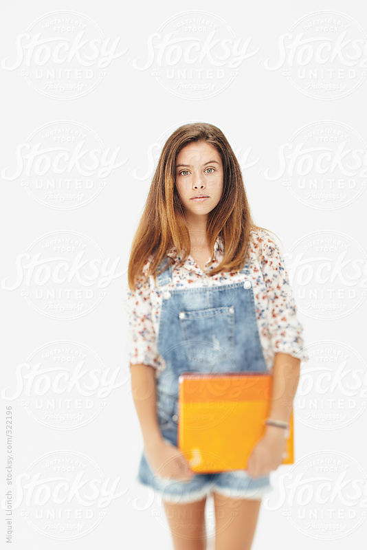 Portrait of a young teenager girl with notebook by Miquel Llonch