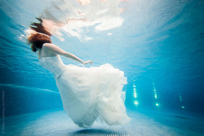 Trash the Dress Underwater Bride Swimming at the Surface by JP Danko