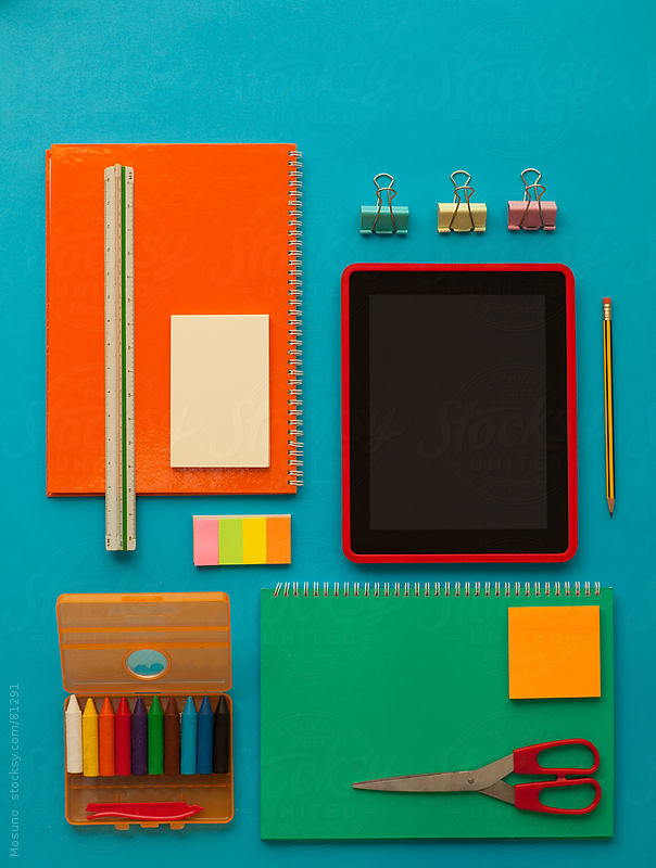 School stuff on the table. by Mosuno