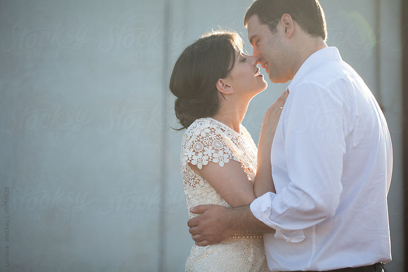 Bride and Groom Kissing by Lumina