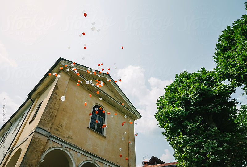 Colorful balloons in the air during a celebration by Simone Becchetti
