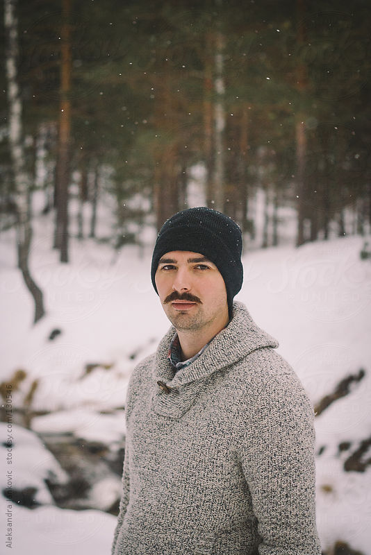 Portrait of a young man with mustache in the nature by Aleksandra Jankovic