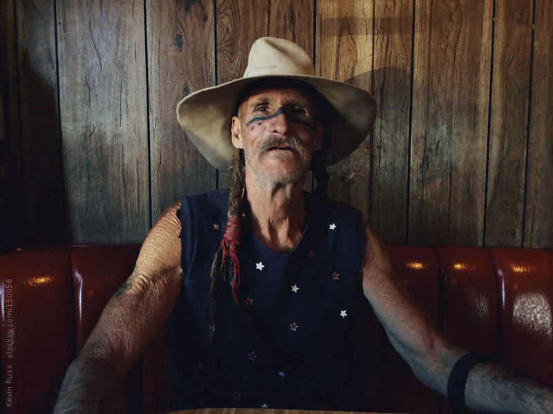 Rough Aged Man Sits in a Diner by Kevin Russ