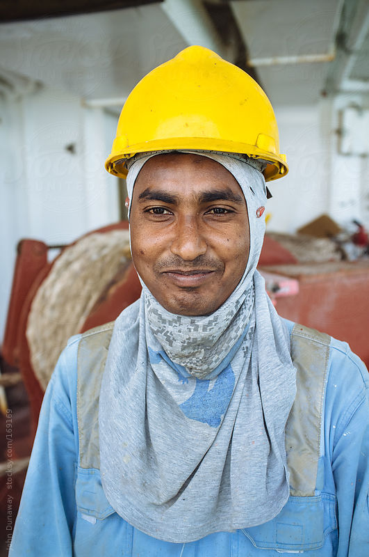 Worker in UAE by John Dunaway