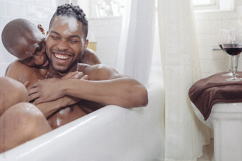 Gay Couple Having Fun Bathing Together in a Bath Tub by Joselito Briones