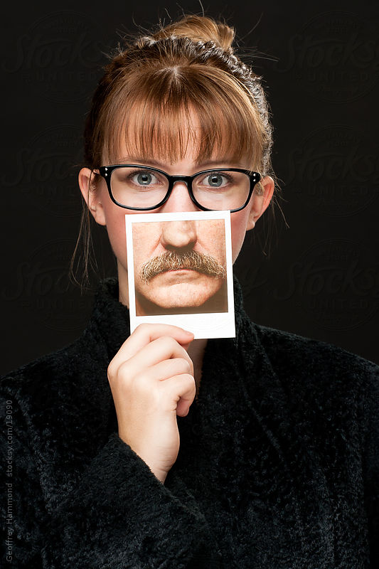 Movember Supporter - Girl with Polaroid of Mustache by Geoffrey Hammond