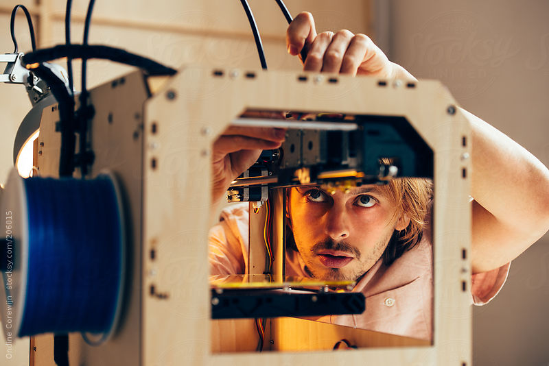 Technician working with 3D printer by Ondine Corewijn