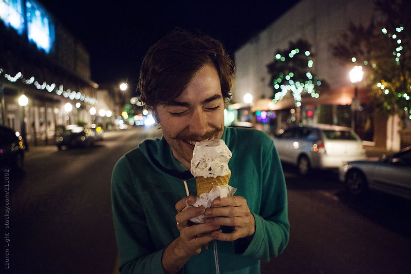 Man Eating Icecream Downtown by Lauren Light
