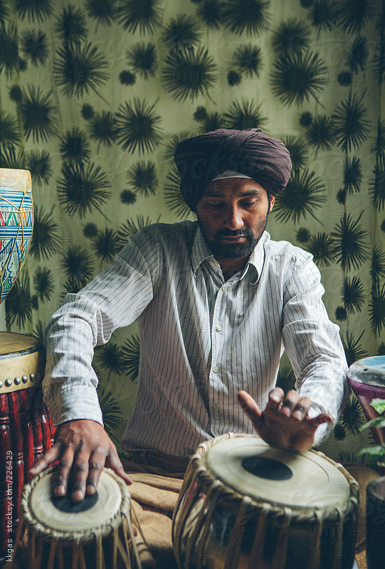 Indian man playing traditional indian drums by kkgas