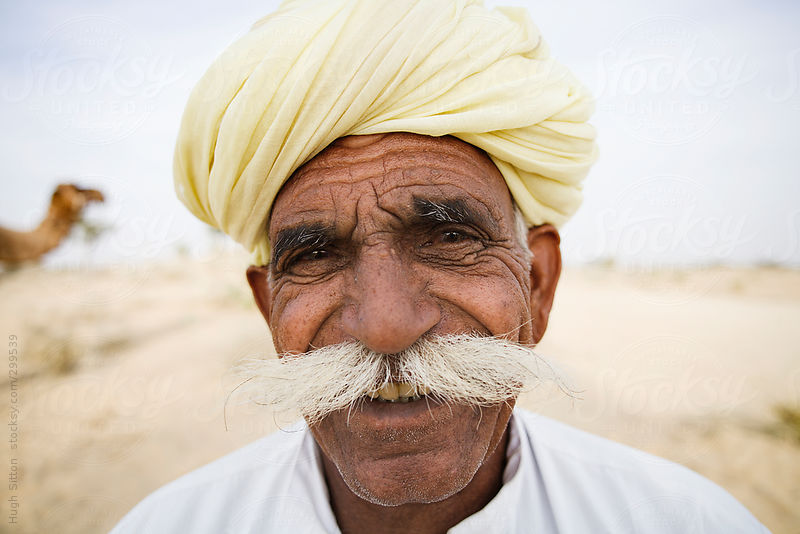 Portrait of Rajasthani man. India. by Hugh Sitton