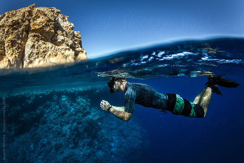Man snorkeling Red Sea by Jovana Milanko