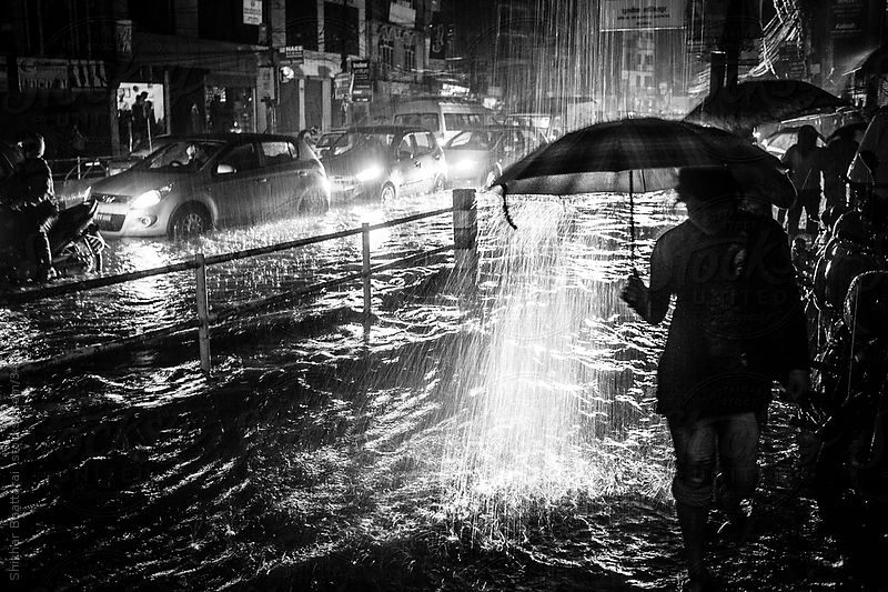 Chaotic monsoon scene of a city street in Asia. by Shikhar Bhattarai
