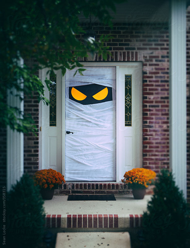 Spooky Halloween Door Wrapped Up As Mummy by Sean Locke