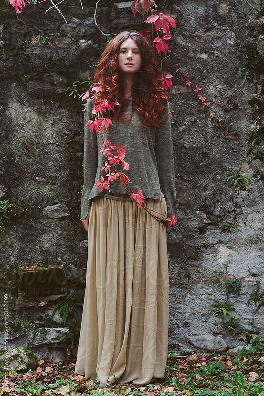 Young beautiful woman with red hair in autumn by Alberto Bogo