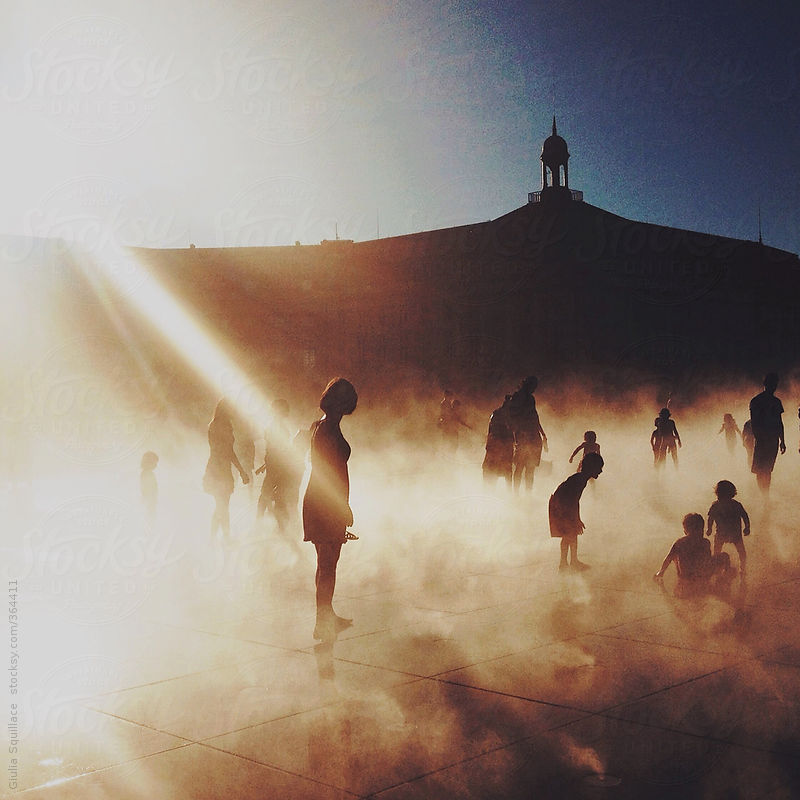 Humans standing in the vapor at sunshine by Guilia Squillace