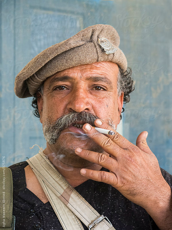 A Cigarette Smoking Tribal Man With Mustaches by Agha Waseem Ahmed