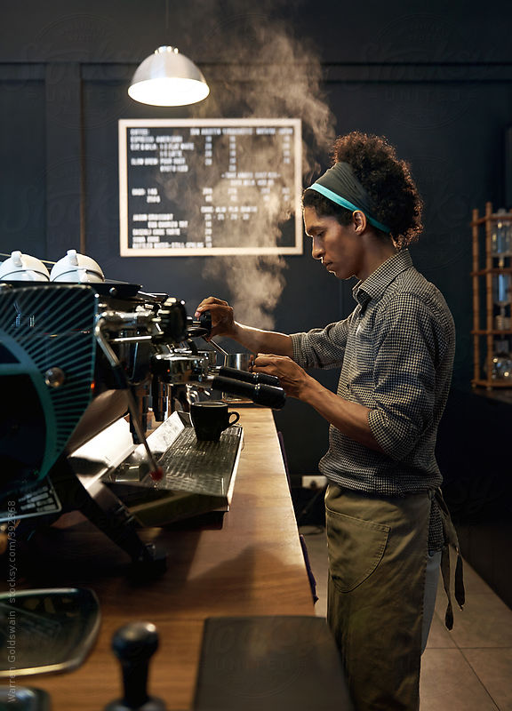 hispanic barista by Warren Goldswain