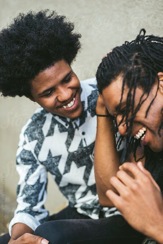 Young black gay couple having fun in urban area by Simone Becchetti