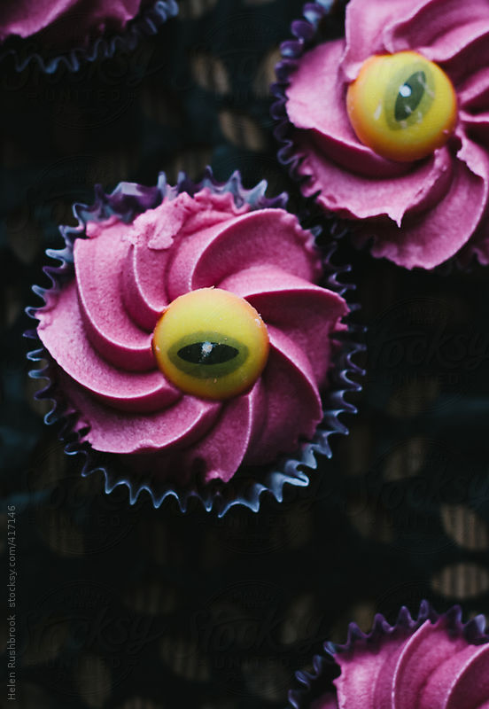 Violently coloured evil eye halloween cupcakes by Helen Rushbrook