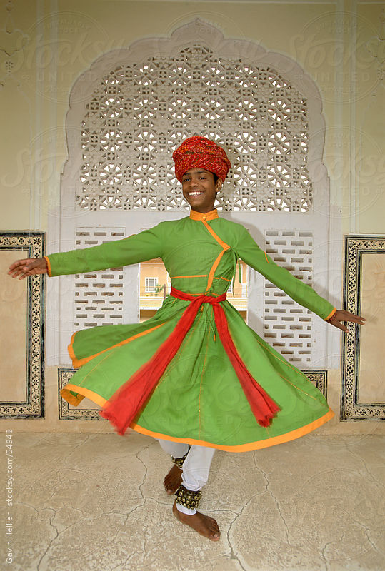 India, Rajasthan, Jaipur, boy dancing in Samode Palace by Gavin Hellier