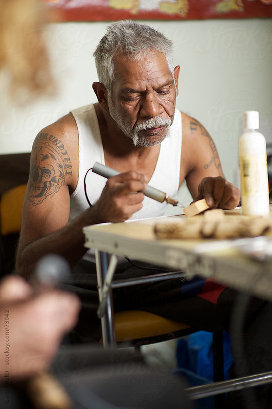 Aboriginal Australian making a Message Stick with Soldering Iron by Gary Radler Photography