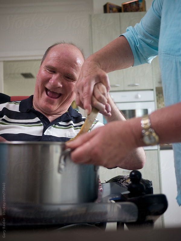 Man Happily Stirring with Assistance by Gary Radler Photography