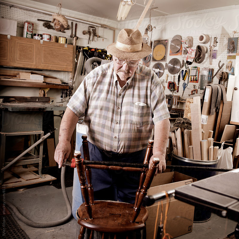 Senior Man in Workshop Repairing Chair by Tyler Olson