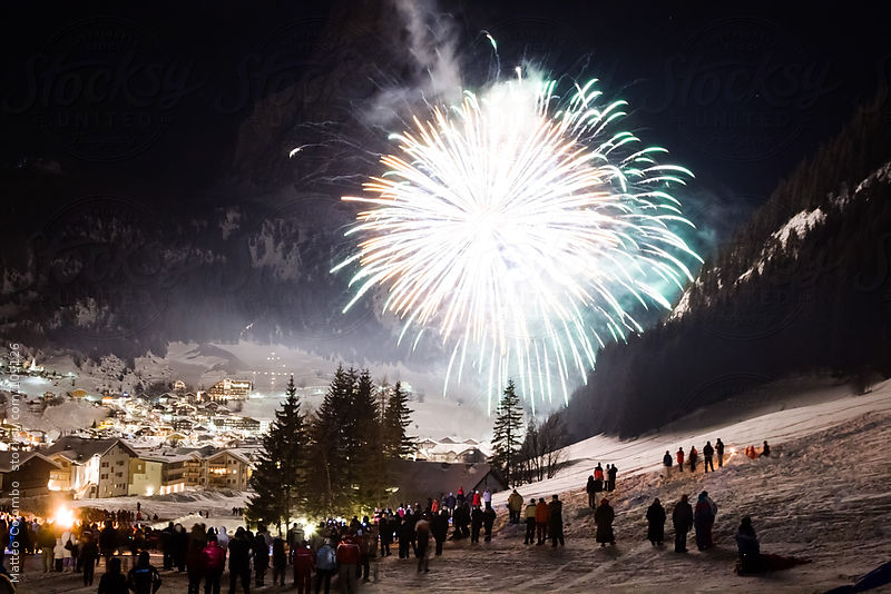 New year's eve fireworks in the mountains, Dolomites, Italy by Matteo Colombo